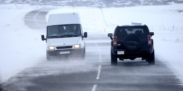 vehicles driving in wintry conditions